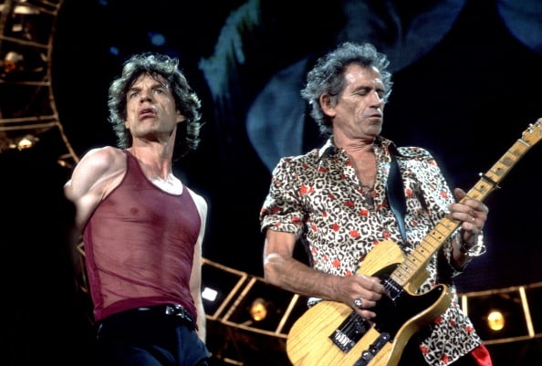 British musicians Mick Jagger (left) and Keith Richards of the Rolling Stones perform on stage during the band's 'Bridges to Babylon' tour, late 1997 or early 1998. (Photo by Paul Natkin/Getty Images)