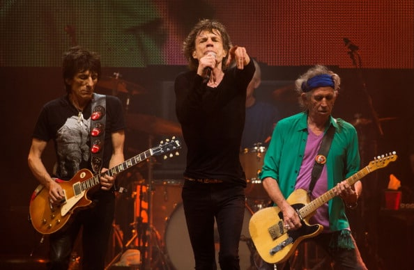 GLASTONBURY, UNITED KINGDOM - JUNE 29:  Ronnie Wood,  Mick Jagger and Keith Richards of the Rolling Stones headline the Pyramid Stage at the Glastonbury Festival of Contemporary Performing Arts at Worthy Farm, Pilton on June 29, 2013 in Glastonbury, England. (Photo by Samir Hussein/Redferns via Getty Images)