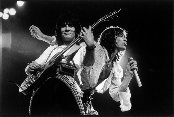 Mick Jagger and Ron Wood on Stage (Photo by Homer Sykes/Corbis via Getty Images)