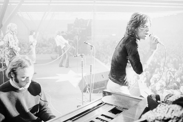 Stephen Stills and Mick Jagger perform live in Amsterdam in 1969. (Photo by Henry Diltz/Corbis via Getty Images)
