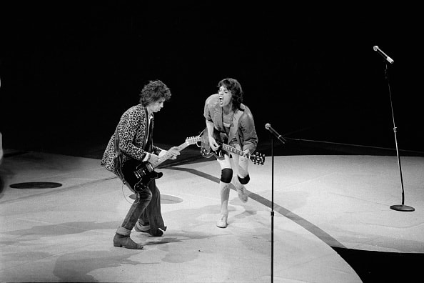 ROLLING STONES AMERICAN TOUR 1981, PHILADELPHIA, U.S.A - 1981: Mick Jagger, lead singer of the British rock group the Rolling Stones, on stage with Keith Richards, during the 1981 concert in the city of Philadelphia, America, USA. (Photo by Derek Hudson/Getty Images)