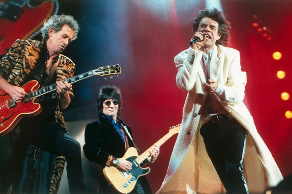 British guitarists Keith Richards and Ronnie Wood, and singer and songwriter Mick Jagger, leader of rock band The Rolling Stones on stage at the Giants Stadium, in New York. (Photo by David Lefranc/Kipa/Sygma via Getty Images)